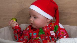 Tutine e vestitini natalizi per neonati